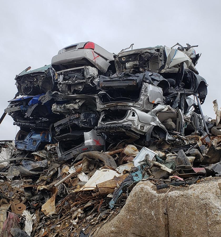 pile of scraped junk cars